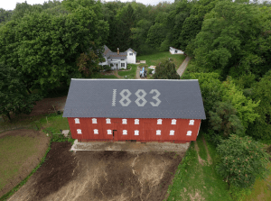 This timber-framed Standard Pennsylvania-style barn was originally erected in 1883. When its slate roof deteriorated beyond repair, it was replaced with a synthetic slate roof manufactured by DaVinci Roofscapes and installed by Absolute Roofing.
