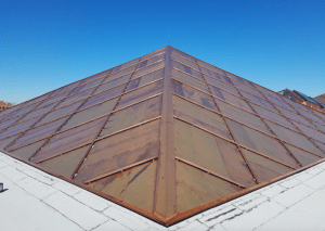 The design of the quilted flat lock copper panel system involved 17 different panel profiles. A false batten was added after the panels were in place.