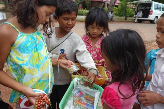Kids working in Cambodia selling bracelets