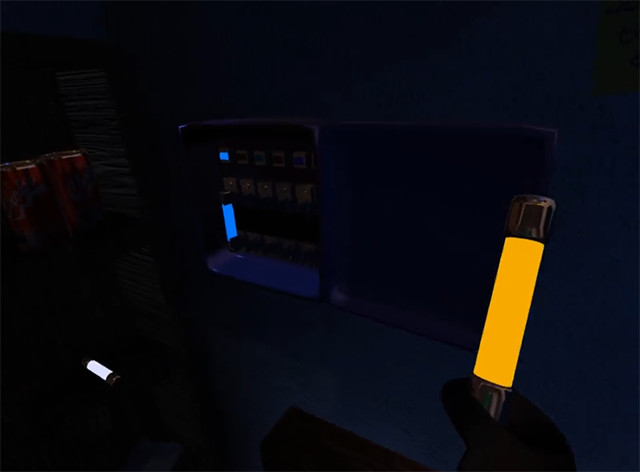 In-game image of a hand holding a glowing object.