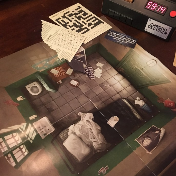 A game mat from Prison Break with a few puzzles and the Chrono Decoder.