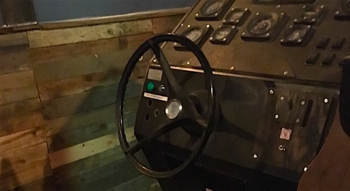 In-game: The ship's wheel and control console.