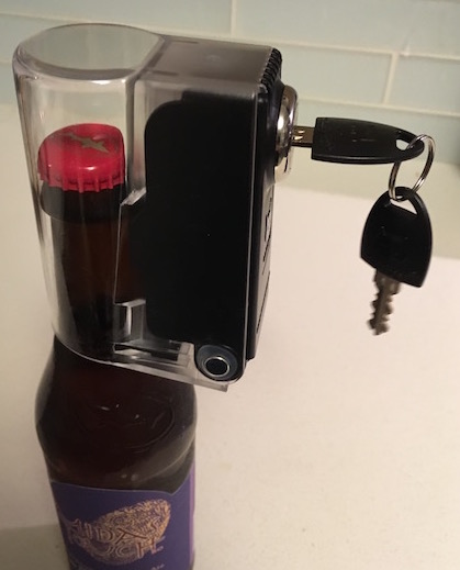 Tantalus Wine and Liquor Bottle Lock secured over a narrow mouthed bottle of beer.