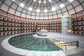 The Prison Dome Breda, an expansive dome with cells along the sides. The open space in the middle has an expansive space for seating and a podium.