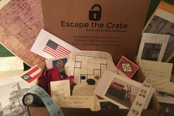 Many of the game's props and components staged. There are ciphers, grids, flags, maps, and photos.