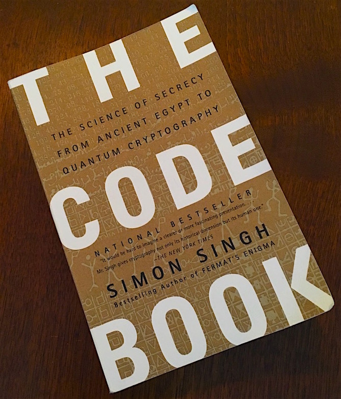 The Code Book's cover has fine writing of assorted encodings covering it.