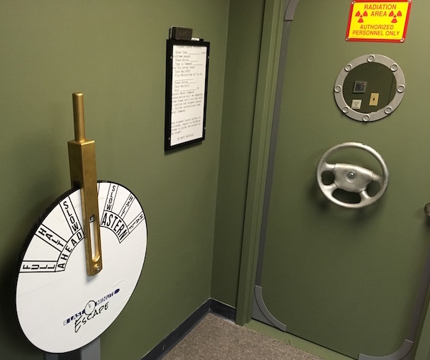 In-game: The depth controller, a door, with a car steering wheel painted silver.