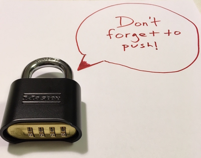 "A 4 digit Masterlock 178 padlock with a text bubble that reads, ""Don't forget to push!"""