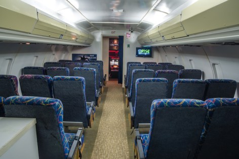 In-game: The gamespace looks exactly like the interior cabin of a commercial airliner.