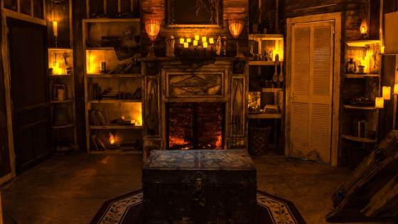 In-game: An old, rundown home that is dramatically candle lit.