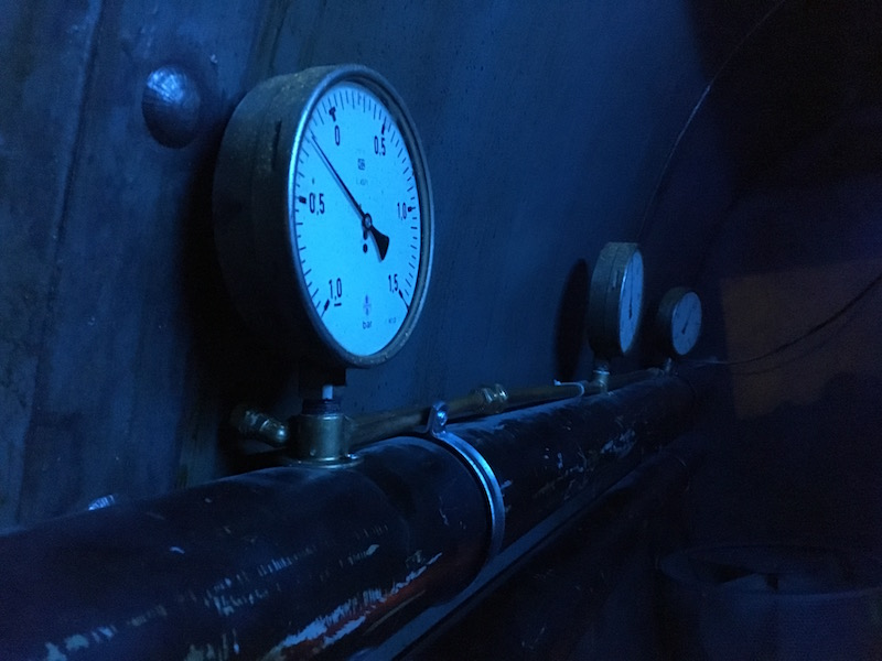 In-game: a close up of a valve on a compelling submarine set.