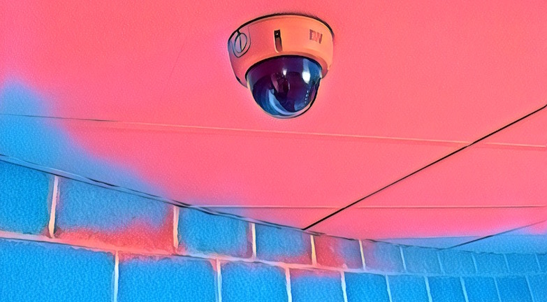 A stylaized image of a security camera hanging from a ceiling.