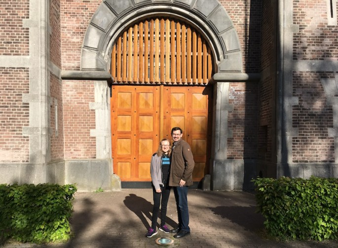 Lisa and David standing in front of the castle-like gates of the Breda Prison Dome