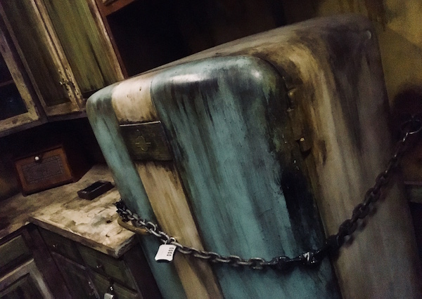 In-game: An old and disgusting blue refrigerator from the 1960s. It's chained and padlocked shut.