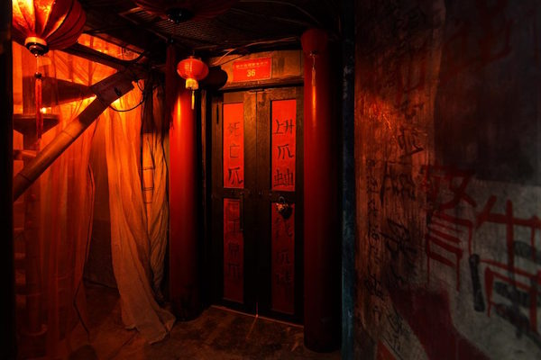 In-game: A dark alley-way in Hong Kong.
