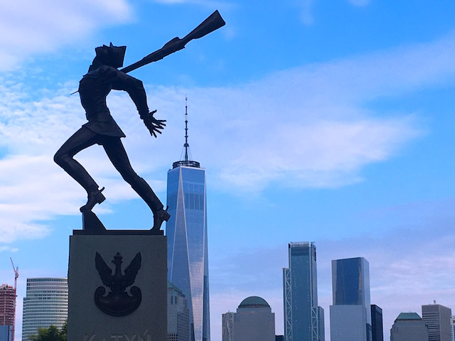 A beautiful image of a WWI memorial, a soldier bayonetted, the Freedom Tower and Lower Manhattan in the background.