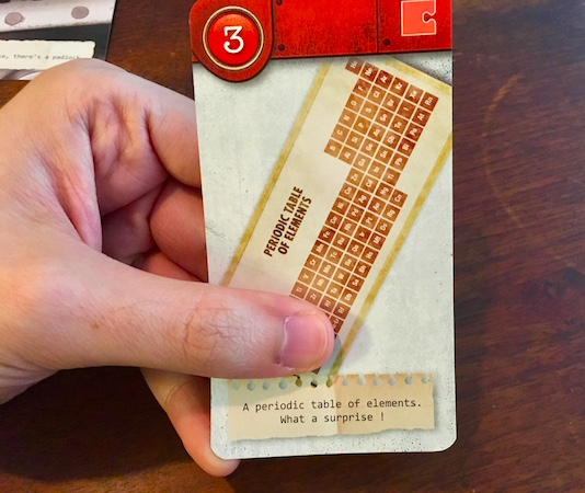 "Red card depicting a periodic table of elements. The flavor text reads, ""A periodic table of elements. What a surprise!"""