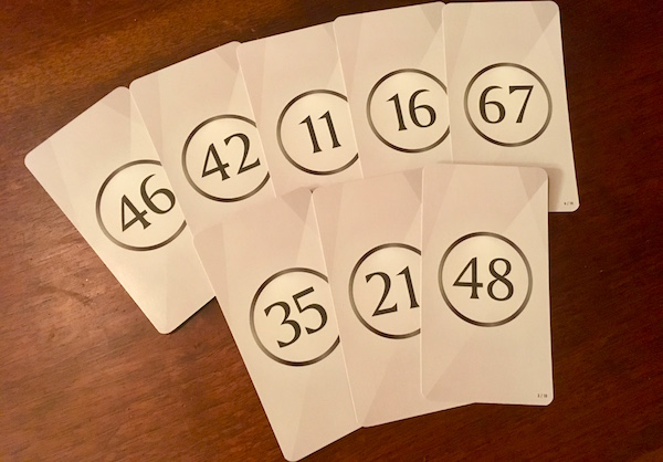 An assortment of facedown numbered cards.