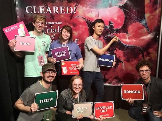 Post-game photo features our team holding up the signs of the character classes that each person played.