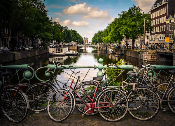 A bridge covered in bicycles over a canal in Amsterdam.