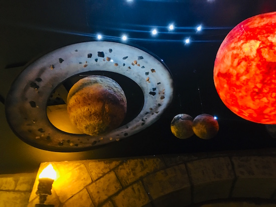 In-game: Models of the planets and sun hanging from the ceiling. Saturn and the Sun look spectacular.
