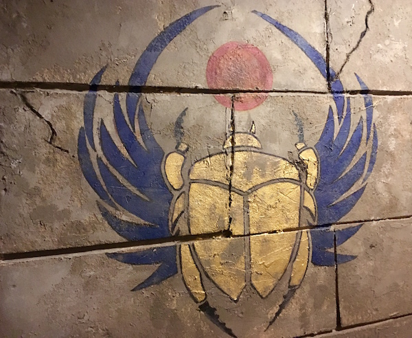 In-game: a scarab painted on the stone wall of an Egyptian tomb.