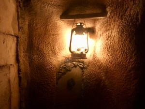 In-game: a lantern illuminating the stone walls of an Egyptian tomb.