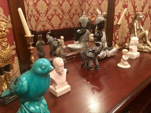 In-game: a shelf covered in statues of birds, elephants, mermaids, and other animals.
