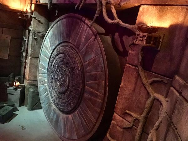 In-game: A massive stone circular temple door.