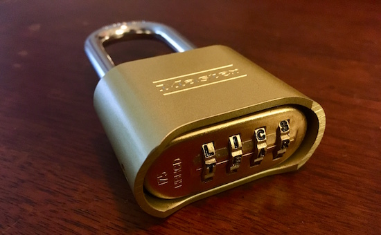 """Master Lock letter lock 175DWD with the word """"TEAR"""" appearing as the combination."""