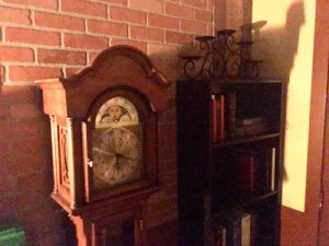 In-game: An old grandfather clock beside a book shelf.