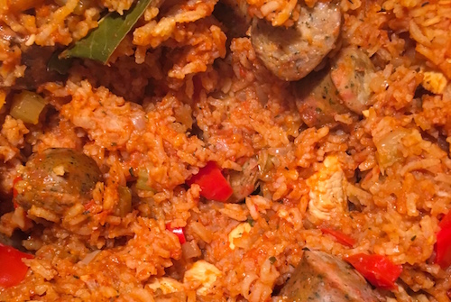 Close up of a pot of chicken and sausage jambalaya.