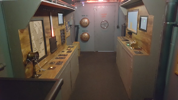 Mobile Room Escape Chicago interior - a submarine lined with puzzle stations.