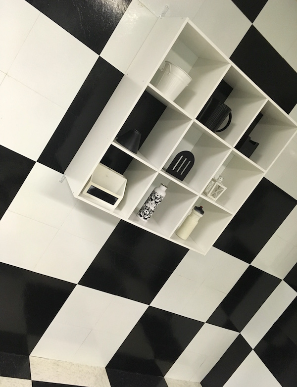 In-game: A black & white checker boarded room.