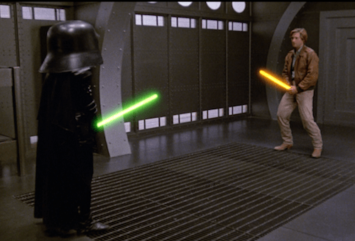 Lonestar & Dark Helmet squaring off in a Schwartz lightsaber fight.