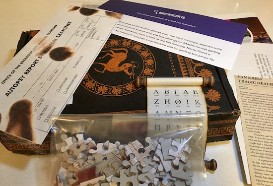 Dispatch by Breakout – On the Run, Box 6 with a jigsaw puzzle, a scroll, and assorted papers from the box.