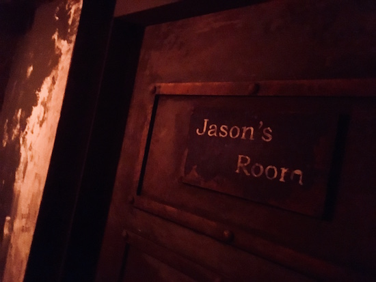 "In-game: A close up of a heavy metal door labeled ""Jason's Room."""
