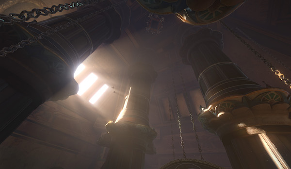 In-game: An upward looking show of large pillars and chains in the pyramid.