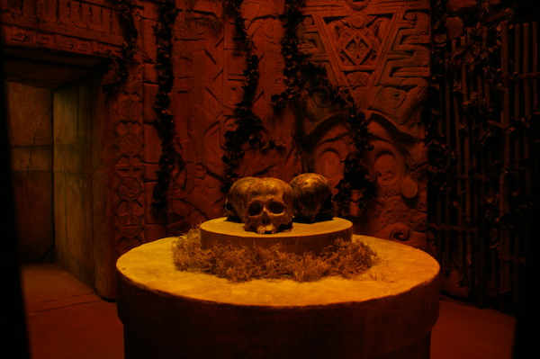 In-game: three skulls resting on a pedestal inside of Mayan ruins.