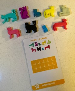 An intermediate puzzle layout for Cat Stax and the corresponding cat pieces.