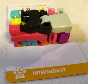 The inter mediate Cat Stax puzzle solved with three layers of cats.