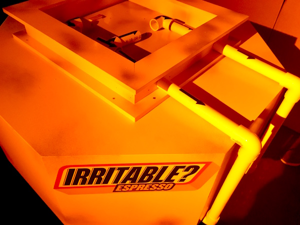 "In-game: A table labeled ""Irritable? Espresso"" has a series of movable piles with arrows."
