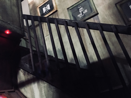 In-game: a stairwell going up in a dark dungeon.