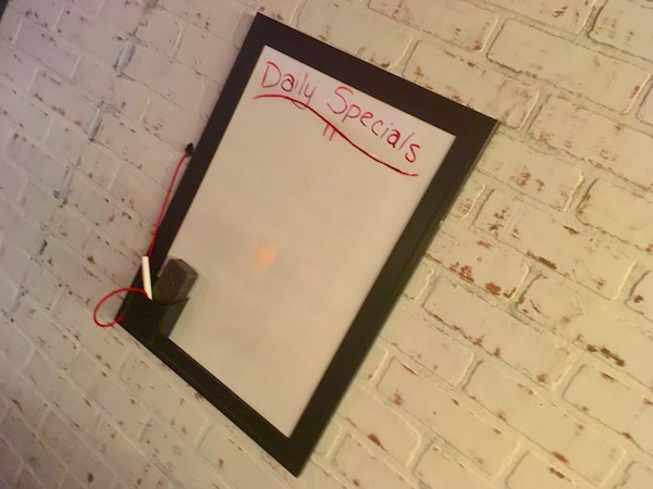 "In-game: The ""Daily Specials"" white board."
