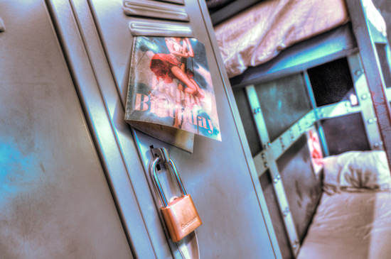 In-game: a shiny filtered image of a birthday card with a pinup girl attached to a locked locker.