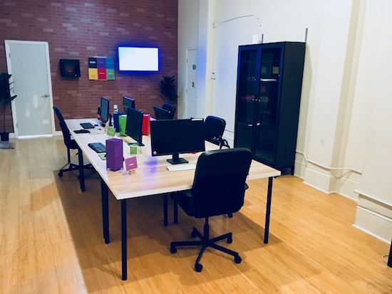 In-game: An open office with 4 desks.