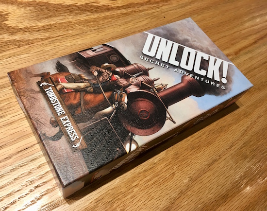 Unlock! Tombstone Express's box, with a beautiful locomotive in an old west scene.
