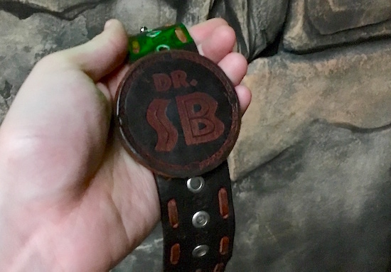 "In-game: a leather bracelet labeled ""Dr. SB."""
