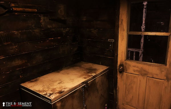 In-game: a large top-loading freezer in a decrepid mud room.