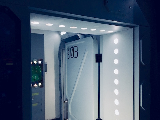 In-game: the futuristic doorway to Lab 03.
